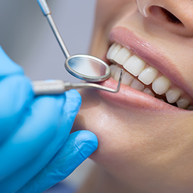 Close-up of patient's teeth being examined